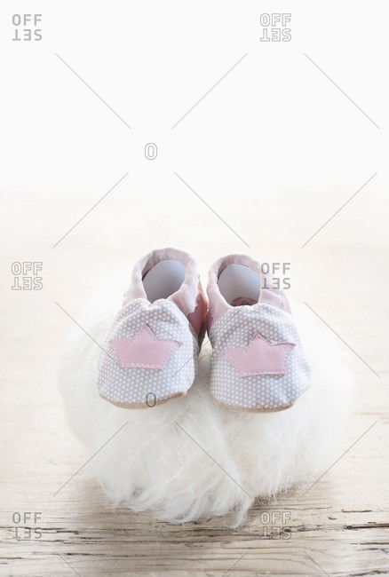Pair of baby shoes on woolen soft ball, Bavaria, Germany