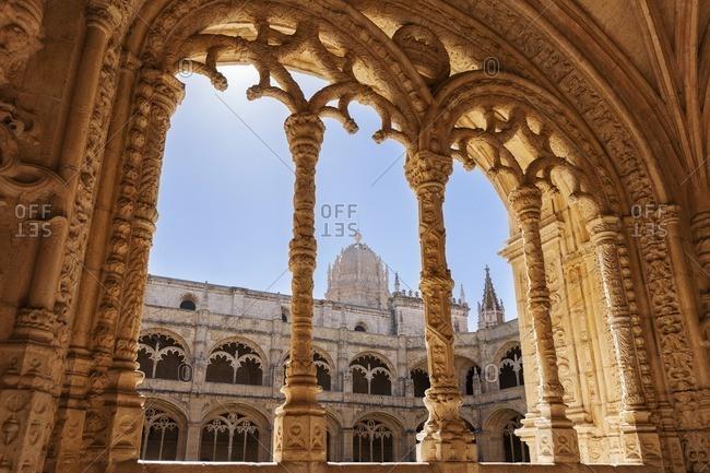 Mosteiro dos Jeronimos viewed through arch, Lisbon, Portugal