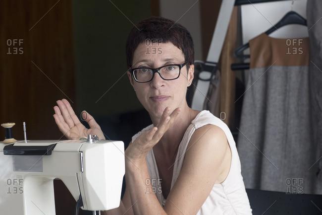 Portrait of a female dressmaker working on sewing machine, Freiburg im Breisgau, Baden-Wurttemberg, Germany