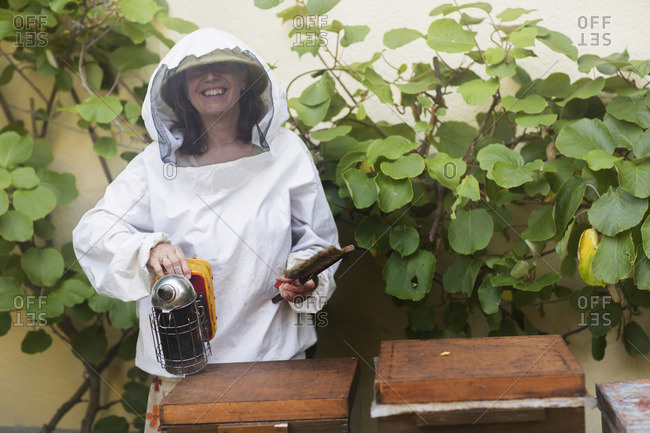 Beekeeper holding smoker, Freiburg im Breisgau, Baden-Wurttemberg, Germany