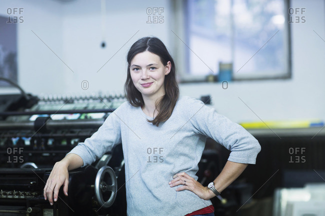 Portrait of a young engineer standing in the industry, Freiburg im Breisgau, Baden-Wurttemberg, Germany