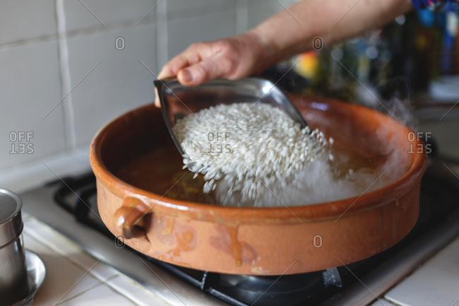 Preparing rice in ceramic pot