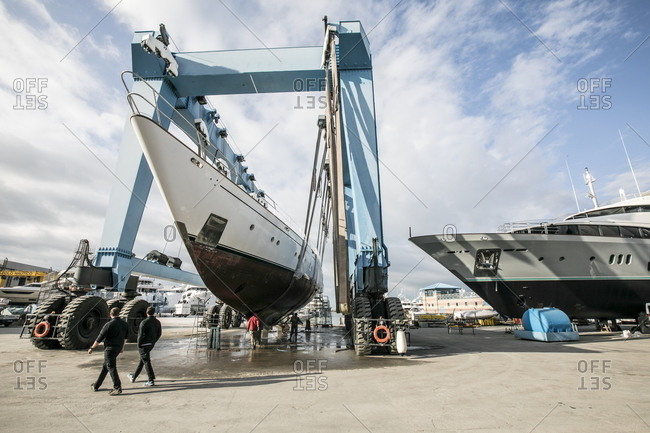 Viareggio, Italy - November 17, 2016: Bow view of yacht hoisted onto truck for maintenance and cleaning in shipyard