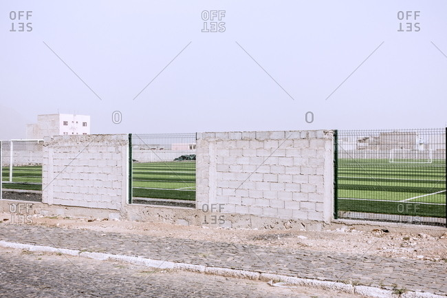 Brick wall around a sports field