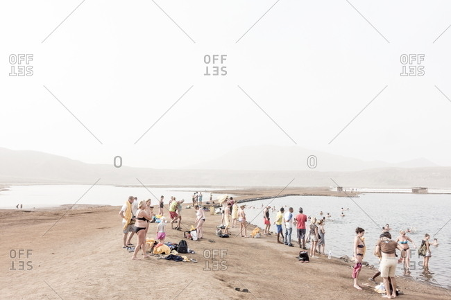 Sal, Cape Verde - December 29, 2016: Tourists along the shore of salt lake at the Pedra Lume Salt Crater