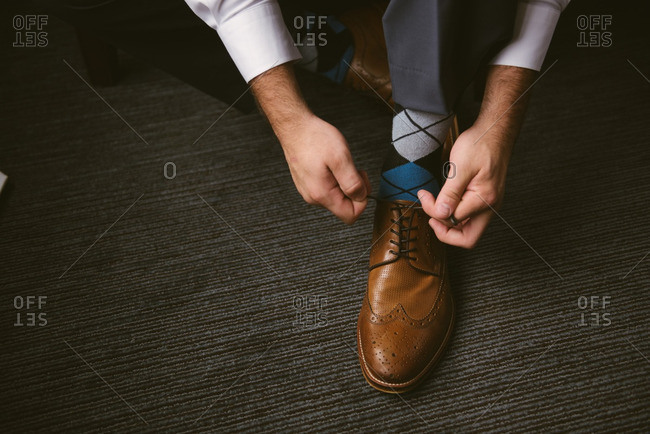 Groom tying up his laces
