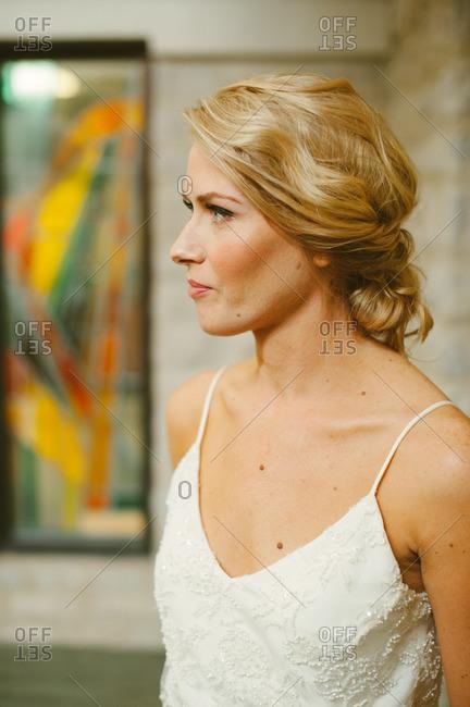 Bride in gown looking away