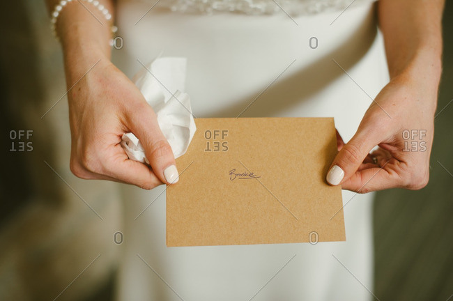 Bride holding a card with her name