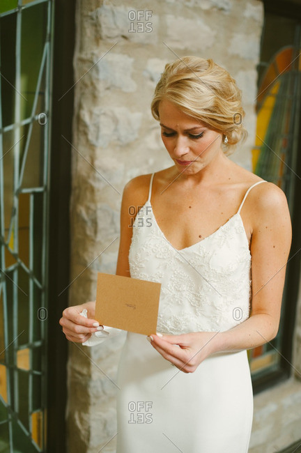 Emotional bride reading a card