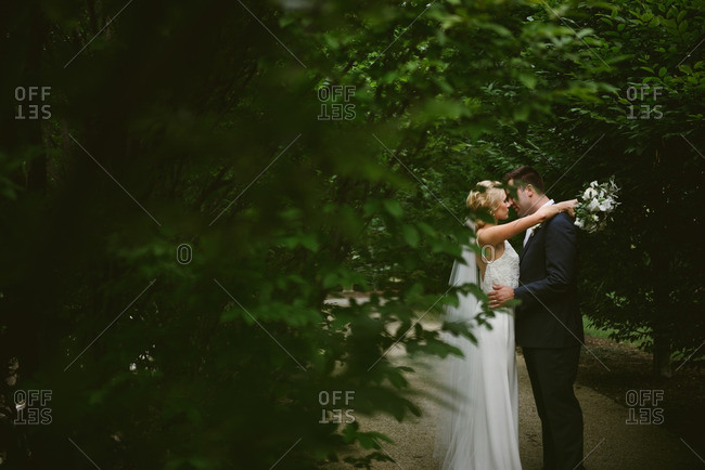 Bride and groom in secluded embrace