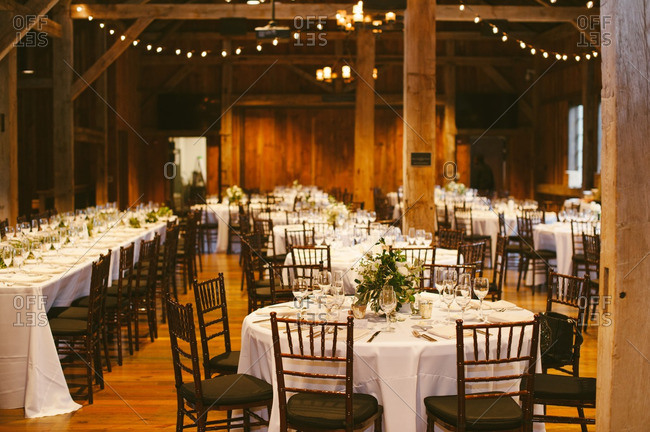 Wedding dinner set up in rustic building