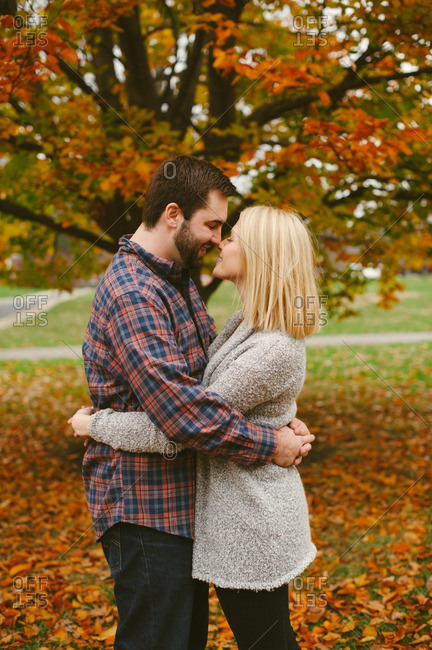 Couple hugging in autumnal setting