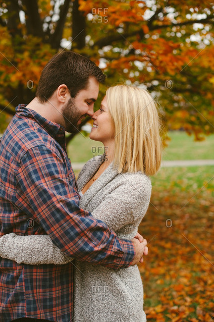 Couple in close hug in autumnal setting