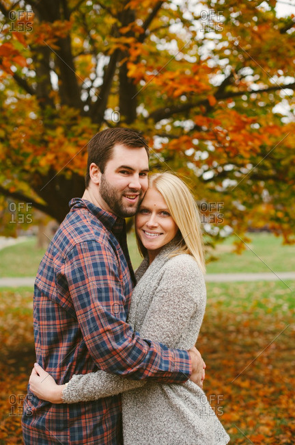 Couple hugging in an autumn setting