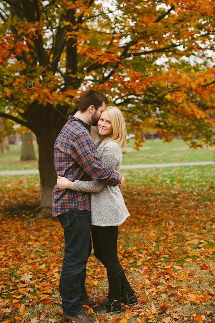 Man hugging woman in autumn setting