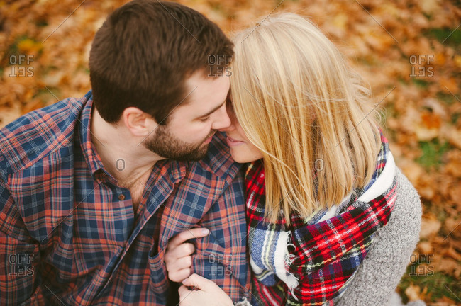 Couple embracing in a fall setting