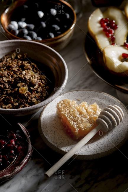 Homemade muesli breakfast with honey and fruits