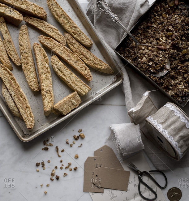 Homemade granola and biscotti being prepared for a gift