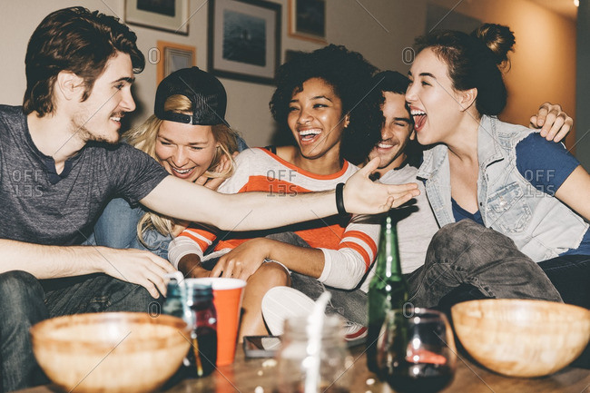 Cheerful multiethnic friends enjoying party at home