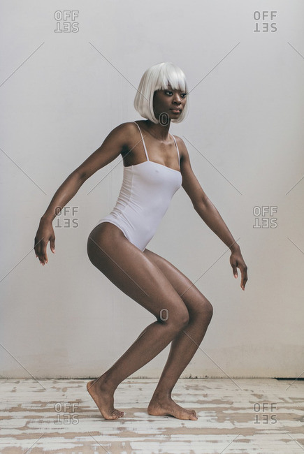 Woman in white wig and white leotard