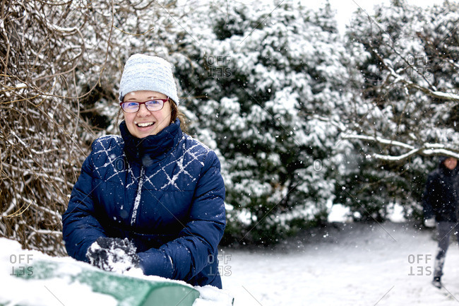 Woman in eyeglasses in snowy backyard