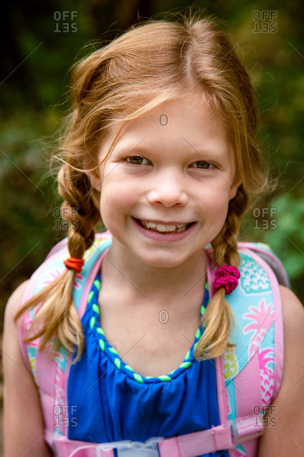 Portrait of a cute young girl with hair in braids