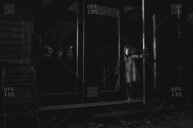 Girl in patterned dress in doorway