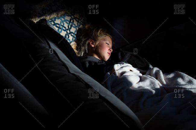 Girl falling asleep on sofa