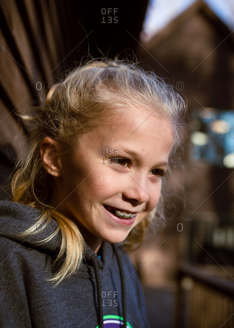 Portrait of a smiling tween girl with braces