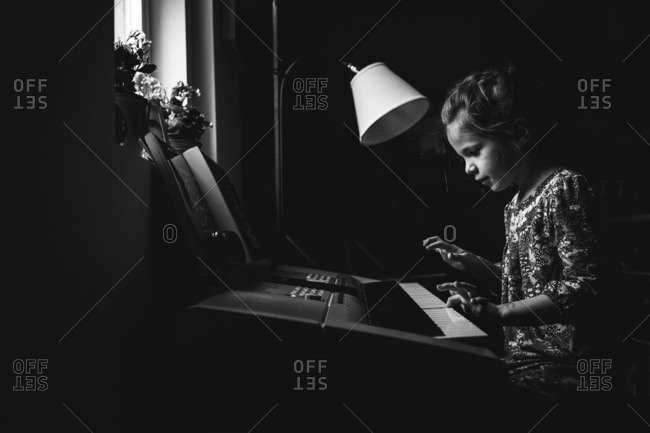 Young girl playing keyboard
