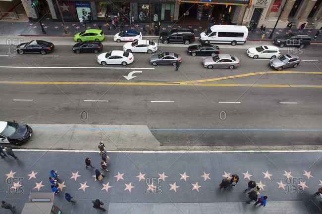Los Angeles, California - January 31, 2016: People walking along the Hollywood Walk of Fame