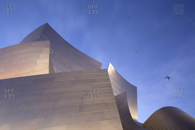 Los Angeles, California - February 1, 2016: Walt Disney Concert Hall with airplane flying above