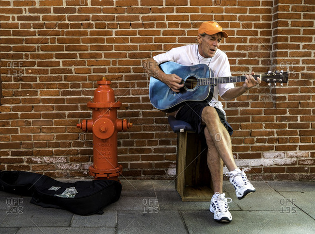 Lancaster, Pennsylvania - July 29, 2016: Man playing guitar in the street