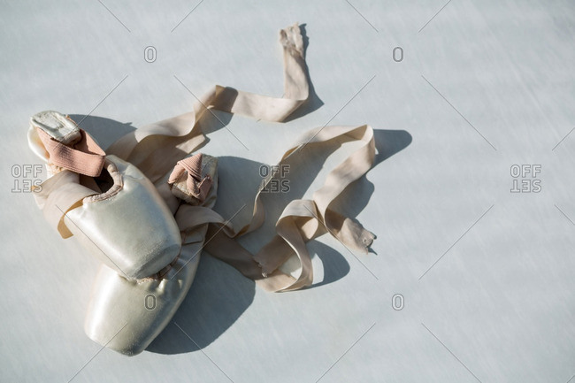 Pair of ballet shoes on floor