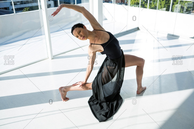 Dancer practicing contemporary dance in dance studio