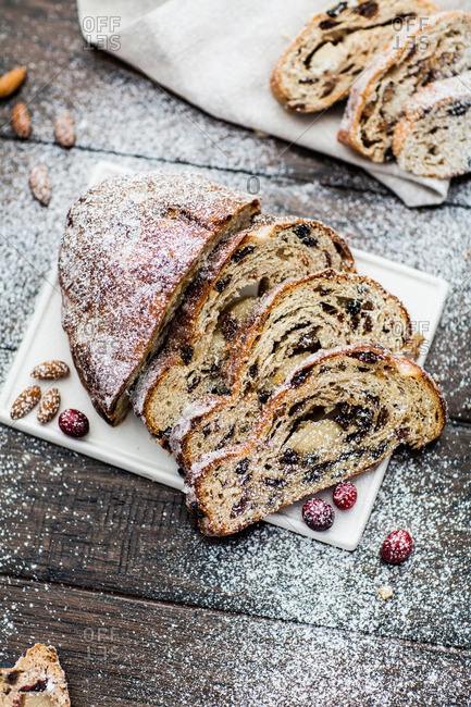 Stollen bread with berries and powdered sugar