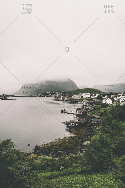 Reine, Norway - August 2, 2016: Foggy mountains by the village of Reine, Norway