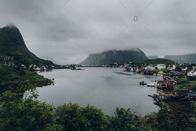 Reine, Norway - August 2, 2016: Mountains surrounded in fog in the village of Reine, Norway