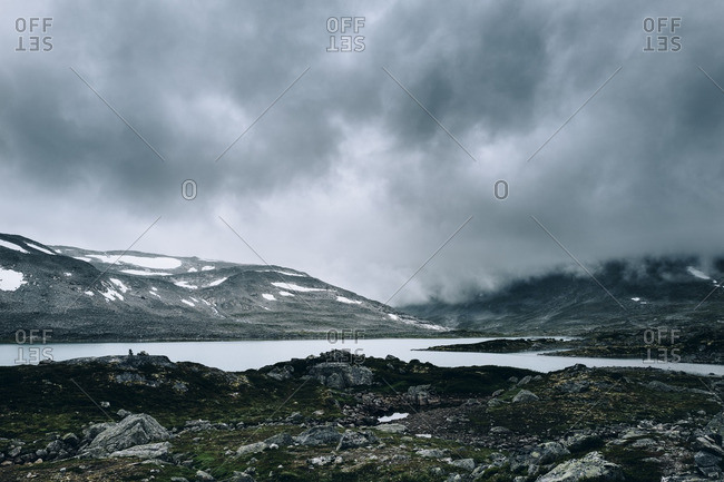 Cloudy sky over lake in the Dalsnibba mountain range