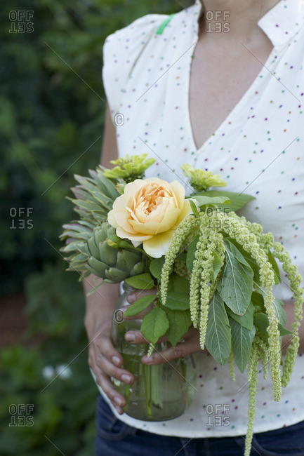 Woman holding garden picked bouquet