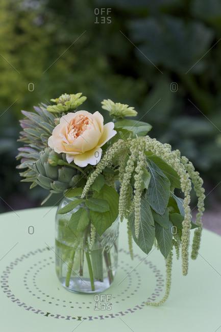 Rustic flower arrangement in glass jar