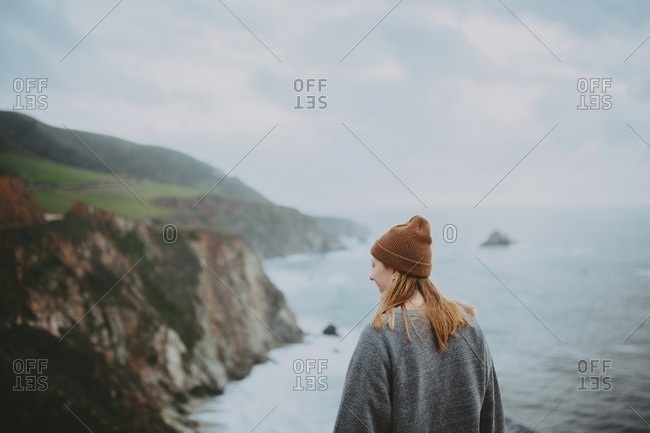 Young woman overlooking sea at Big Sur