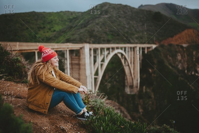 Woman enjoying overlook at Bixby Creek Bridge, Big Sur