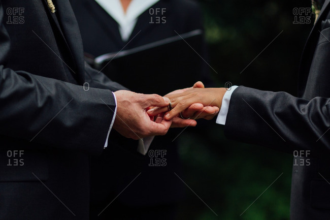 Grooms exchanging their wedding rings