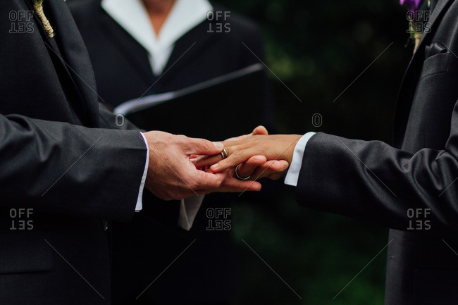 Grooms exchanging their wedding bands
