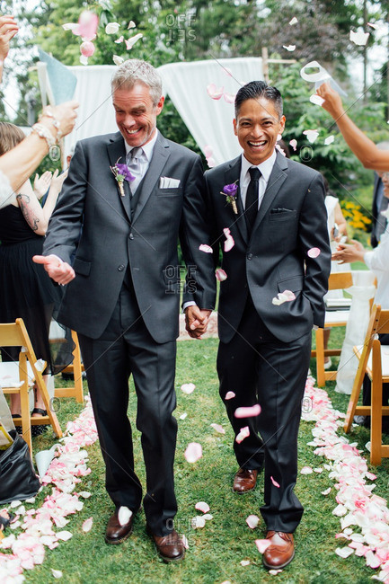 Grooms walking aisle after ceremony