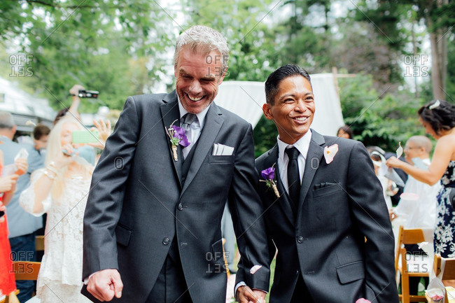 Grooms walking down aisle after ceremony