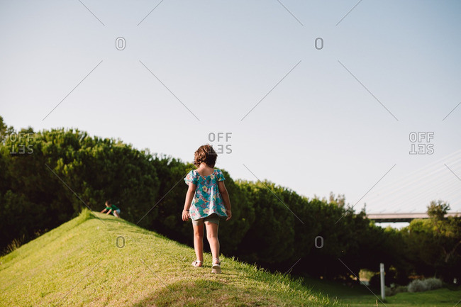 Girl walking on mound in park