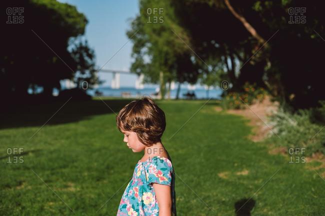 Girl strolling in riverside park