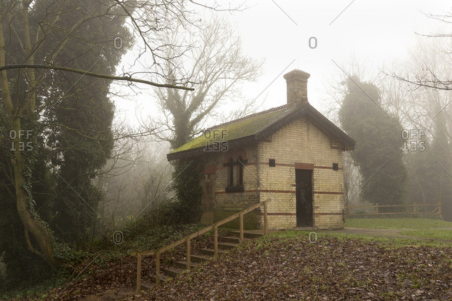 Small brick building in fog, England